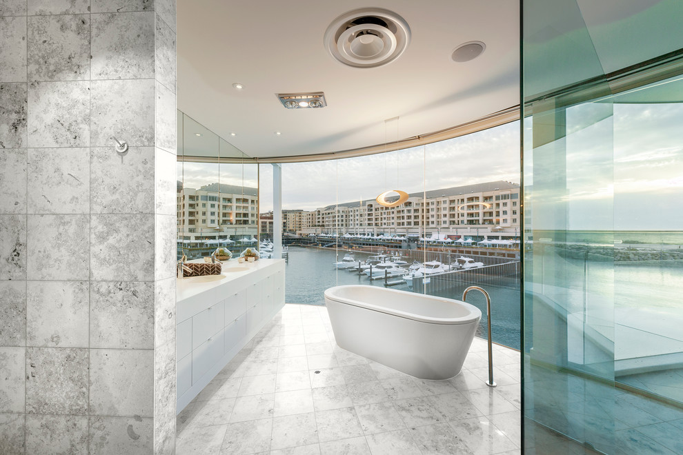 Example of a mid-sized trendy master freestanding bathtub design in Adelaide with flat-panel cabinets and white cabinets