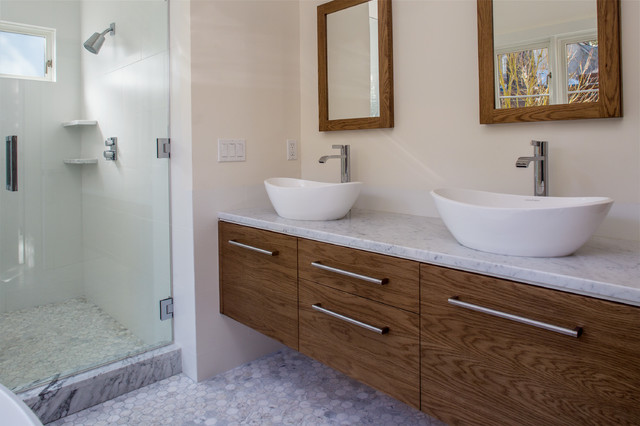 Photo of a modern bathroom in San Francisco with a vessel sink, flat-panel cabinets, medium wood cabinets, marble worktops, a freestanding bath, an alcove shower, white tiles, porcelain tiles, white walls and marble flooring.