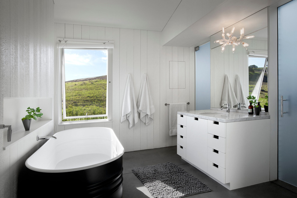 Freestanding bathtub - cottage freestanding bathtub idea in San Francisco with an undermount sink, flat-panel cabinets, white cabinets and white walls