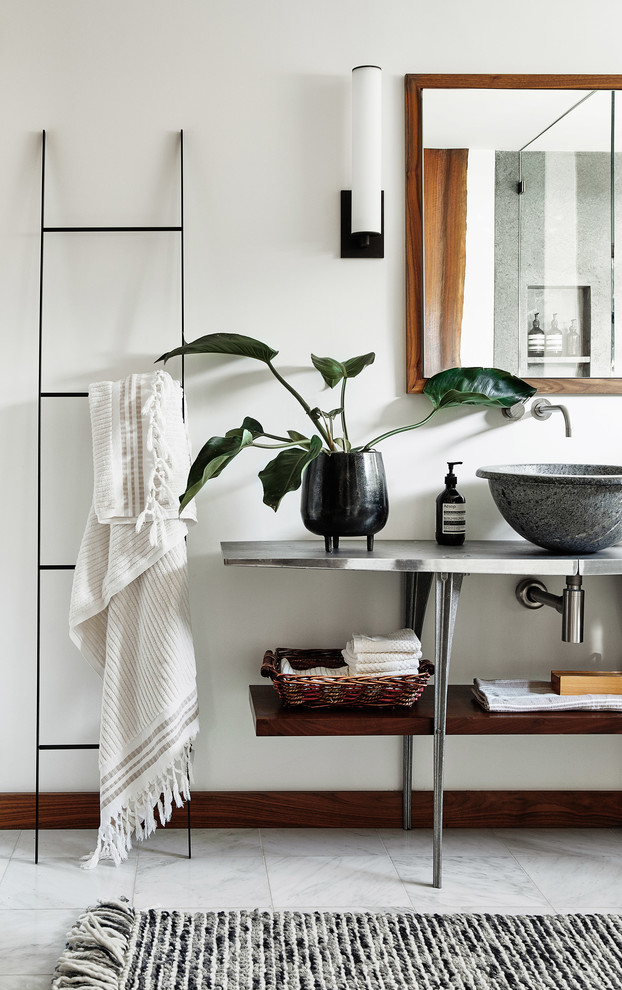 Inspiration for a contemporary white floor bathroom remodel in San Francisco with open cabinets, white walls, a vessel sink, stainless steel countertops and gray countertops