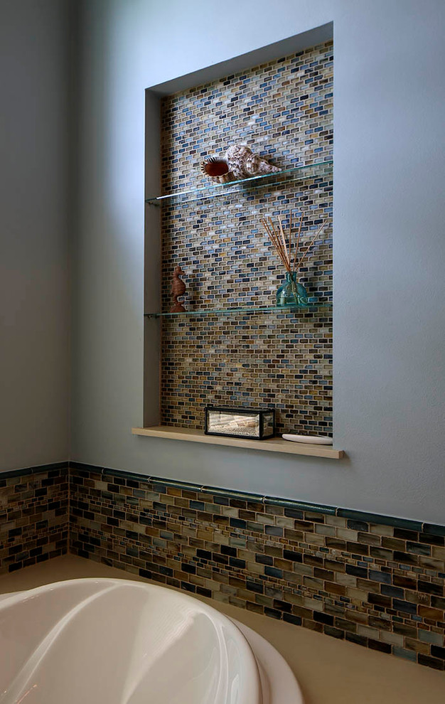 Mid-sized transitional blue tile and mosaic tile porcelain floor drop-in bathtub photo in New Orleans with shaker cabinets, medium tone wood cabinets, engineered quartz countertops and blue walls