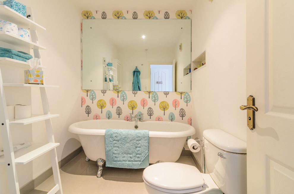 Small trendy claw-foot bathtub photo in Belfast with multicolored walls