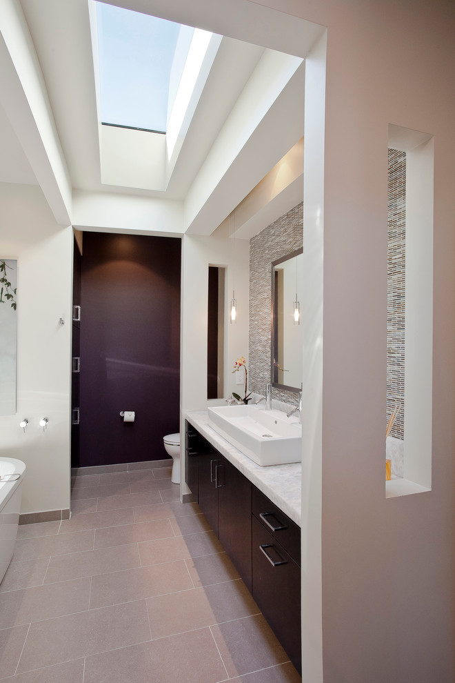 Trendy mosaic tile and gray tile freestanding bathtub photo in San Francisco with a trough sink, flat-panel cabinets and dark wood cabinets