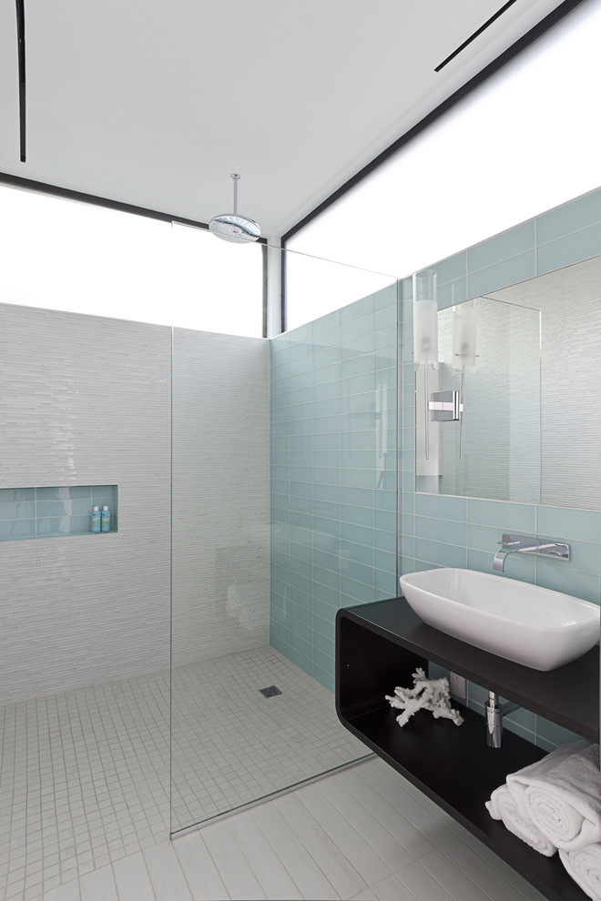 Walk-in shower - modern glass tile and blue tile porcelain tile and gray floor walk-in shower idea in Houston with wood countertops, white walls, black countertops and a niche