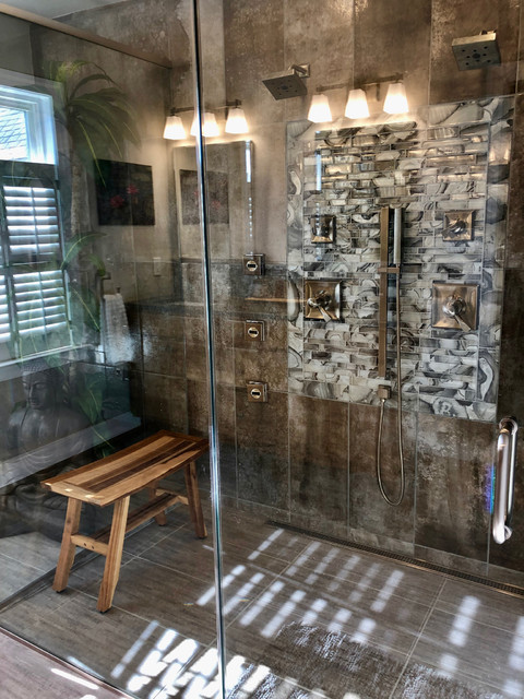 Mid-sized transitional master gray tile and porcelain tile porcelain floor and gray floor walk-in shower photo in Philadelphia with shaker cabinets, medium tone wood cabinets, a two-piece toilet, gray walls, an undermount sink, a hinged shower door and gray countertops