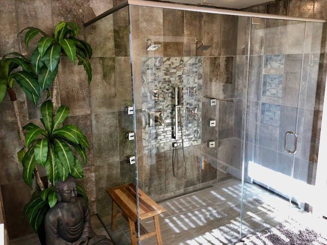 Walk-in shower - mid-sized transitional master gray tile and porcelain tile porcelain floor and gray floor walk-in shower idea in Philadelphia with shaker cabinets, medium tone wood cabinets, a two-piece toilet, gray walls, an undermount sink, a hinged shower door and gray countertops