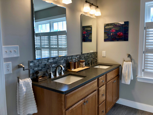Inspiration for a mid-sized transitional master gray tile and glass tile porcelain floor and gray floor walk-in shower remodel in Philadelphia with shaker cabinets, medium tone wood cabinets, a two-piece toilet, gray walls, an undermount sink, a hinged shower door and gray countertops