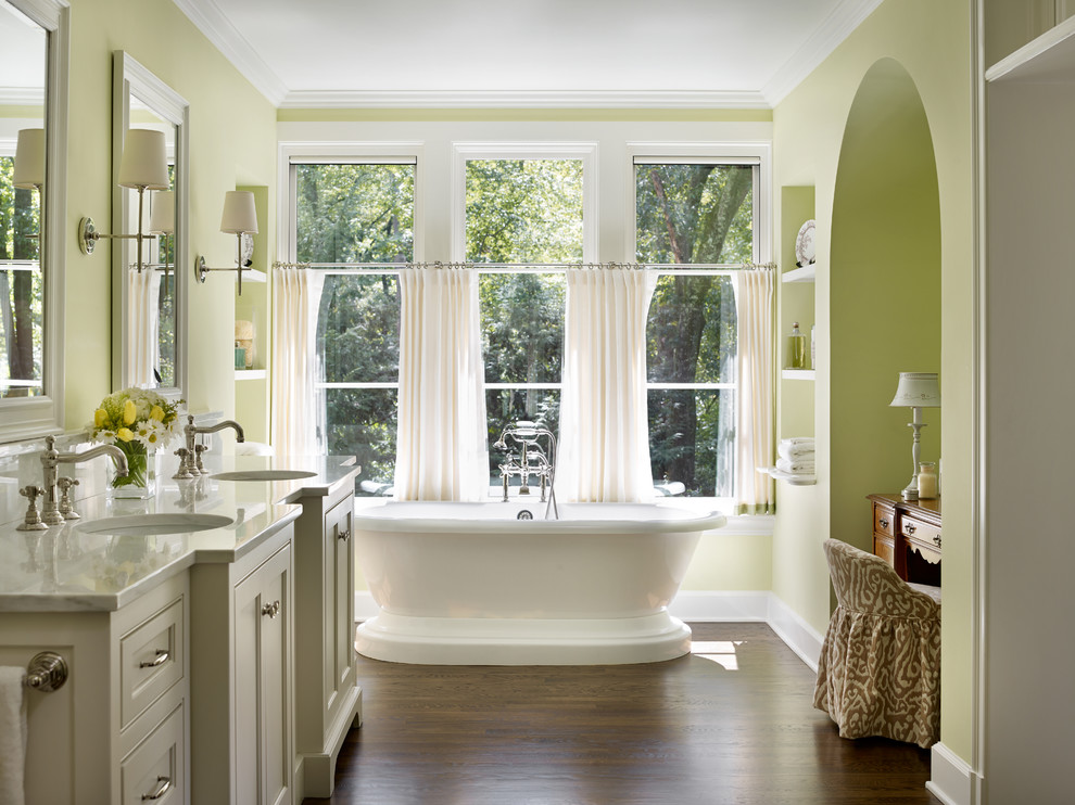 Freestanding bathtub - traditional master dark wood floor freestanding bathtub idea in Atlanta with gray cabinets, green walls, an undermount sink and recessed-panel cabinets