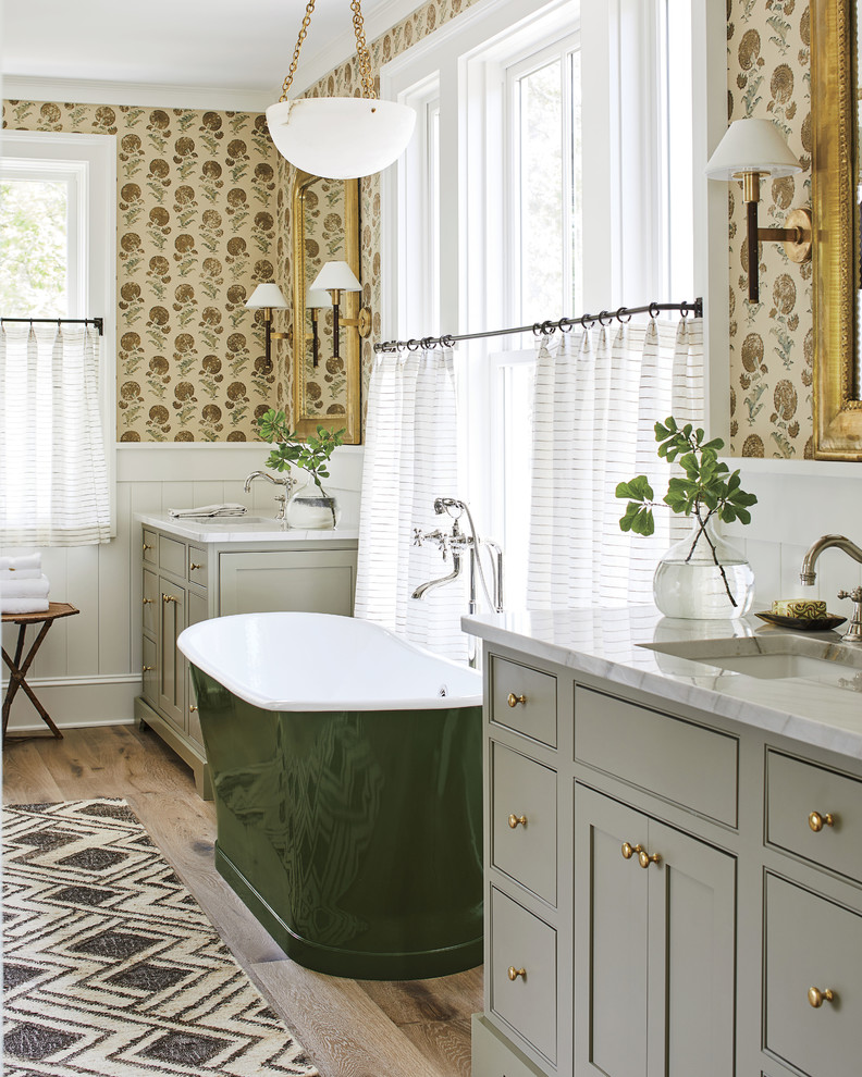 Freestanding bathtub - coastal master freestanding bathtub idea in Jacksonville with beaded inset cabinets, gray cabinets, multicolored walls, an undermount sink and white countertops