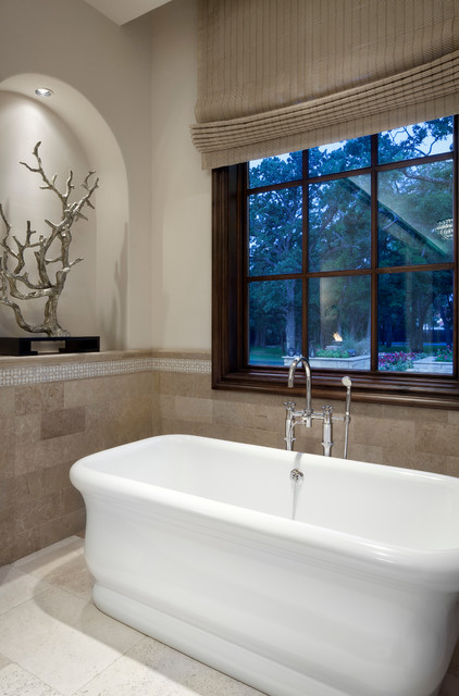 Example of a tuscan freestanding bathtub design in Austin