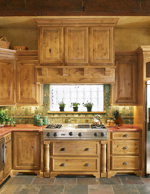 Is that a glass block window above the range? Does the cabinet above it house a range hood?