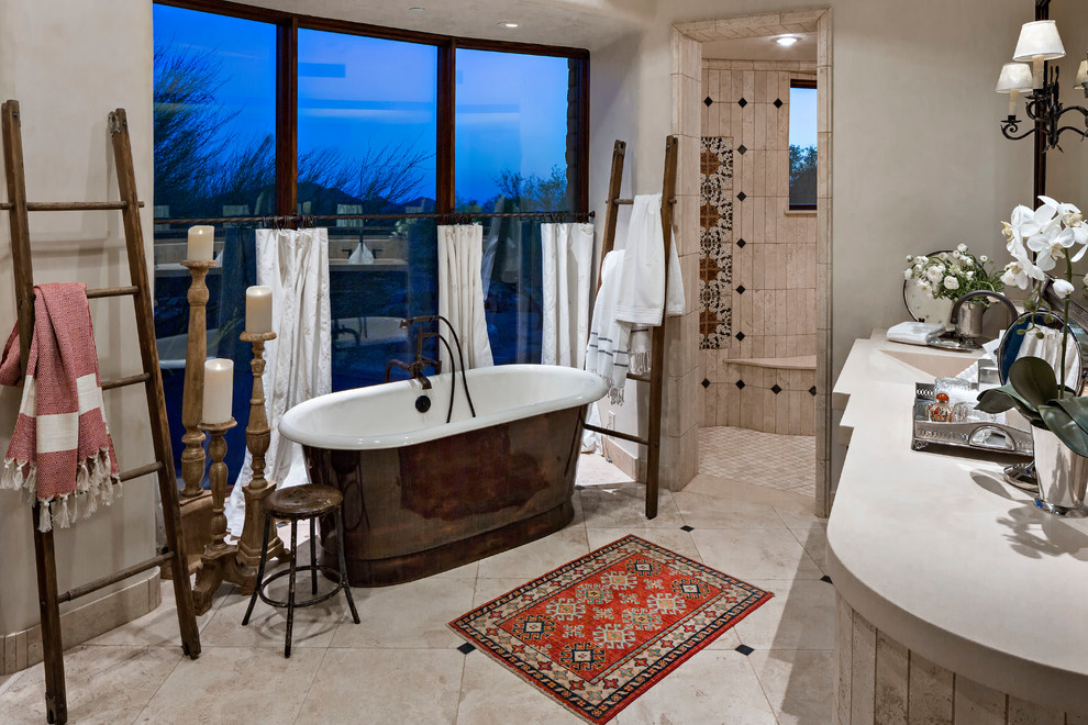Mid-sized southwest master beige tile and travertine tile travertine floor and beige floor bathroom photo in Phoenix with beige walls and an integrated sink