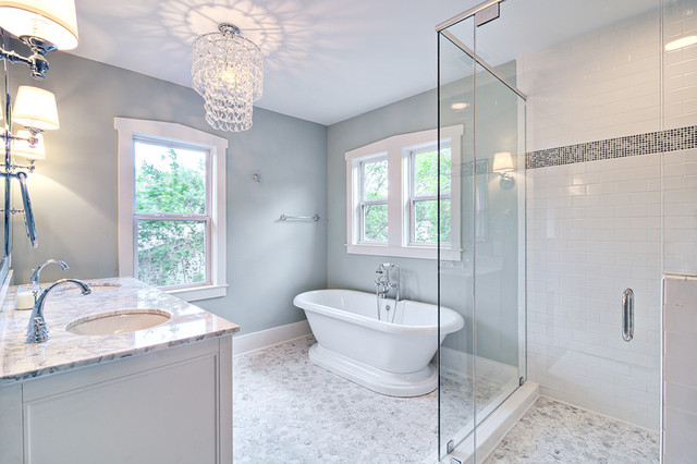 Spa-like master bath with glass chandelier and pedestal tub traditional bathroom