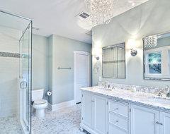 Spa-like master bath with glass chandelier and pedestal tub traditional-bathroom