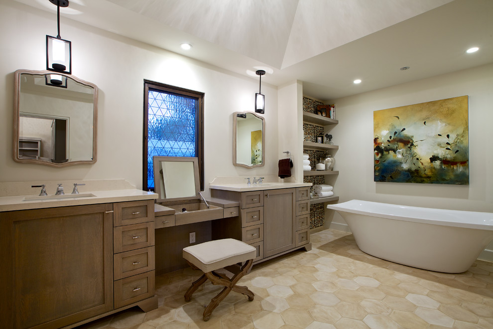 Large tuscan master travertine floor and beige floor freestanding bathtub photo in San Diego with an undermount sink, shaker cabinets, white walls and dark wood cabinets