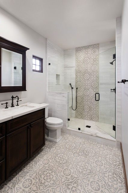 Tuscan 3/4 beige tile, gray tile and white tile multicolored floor alcove shower photo in San Diego with furniture-like cabinets, dark wood cabinets, a two-piece toilet, gray walls, an undermount sink, a hinged shower door and white countertops