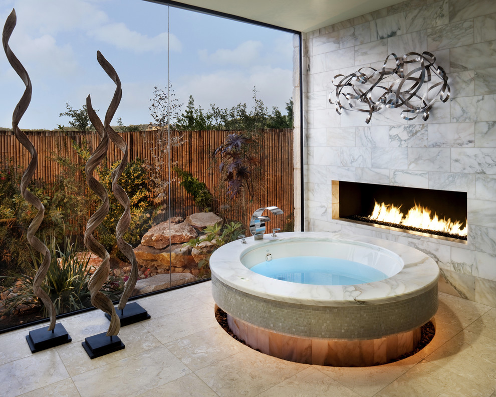 Example of a trendy beige tile bathroom design in Austin with a hot tub
