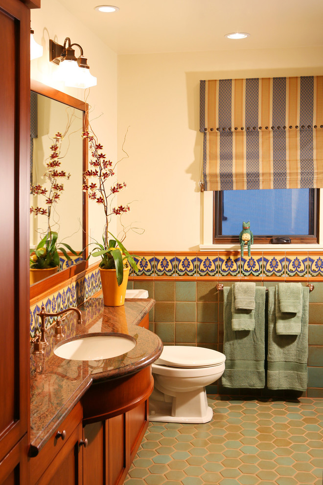 Bathroom - mediterranean multicolored tile terra-cotta tile bathroom idea in Los Angeles with an undermount sink, shaker cabinets and medium tone wood cabinets