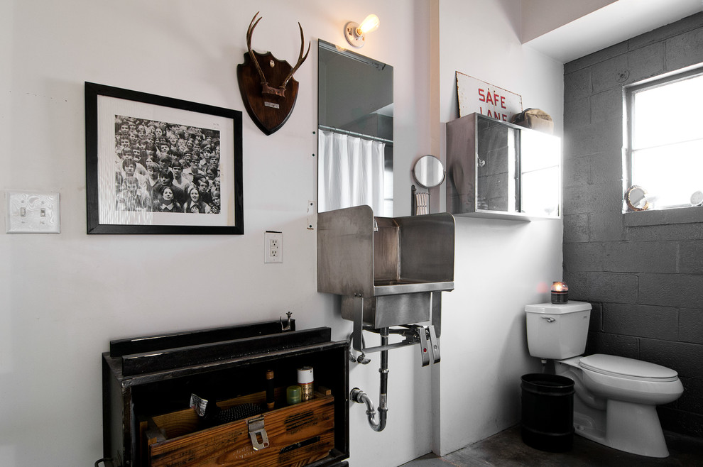 Urban bathroom photo in Salt Lake City with a wall-mount sink