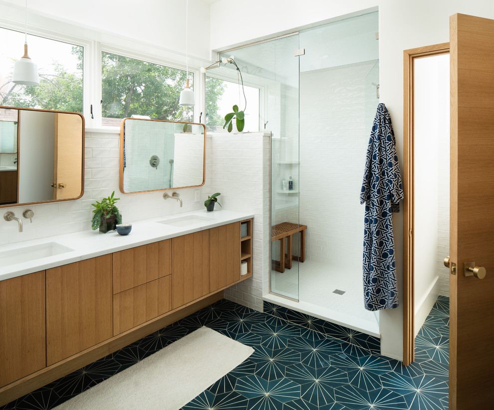 Example of a 1950s master white tile and subway tile green floor alcove shower design in Denver with flat-panel cabinets, light wood cabinets, white walls, an undermount sink, a hinged shower door and white countertops
