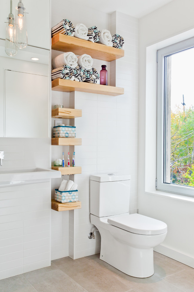 Inspiration for a small contemporary white tile and subway tile bathroom remodel in Toronto with open cabinets and a two-piece toilet