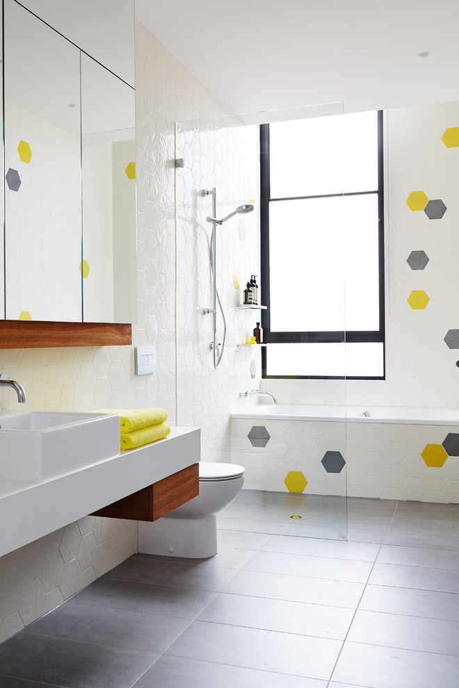Mid-sized danish kids' ceramic tile and multicolored tile porcelain tile bathroom photo in Melbourne with a vessel sink, white walls, quartz countertops and a one-piece toilet