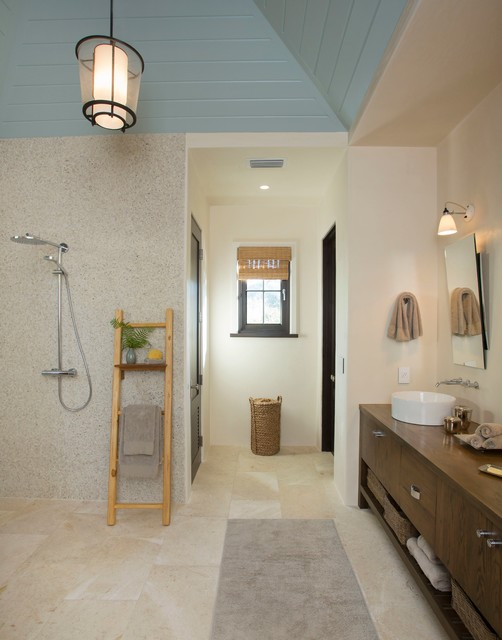Inspiration for a tropical master beige tile bathroom remodel in Charleston with a vessel sink, flat-panel cabinets, dark wood cabinets, wood countertops and beige walls