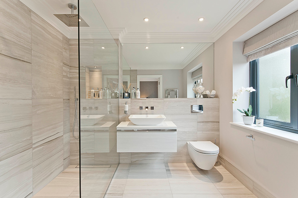 Trendy walk-in shower photo in Surrey with a wall-mount toilet and a vessel sink
