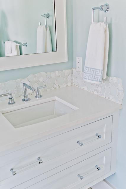 Inspiration for a mid-sized beach style white tile bathroom remodel in Jacksonville with beaded inset cabinets, white cabinets, blue walls and marble countertops
