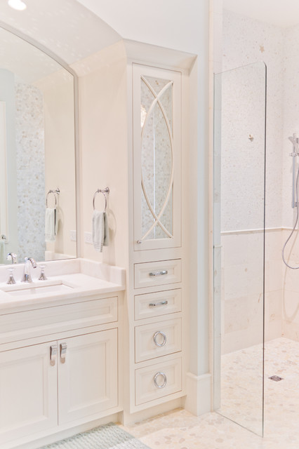 Bathroom - mid-sized beach style master white tile pebble tile floor bathroom idea in Jacksonville with beaded inset cabinets, white cabinets, white walls and marble countertops