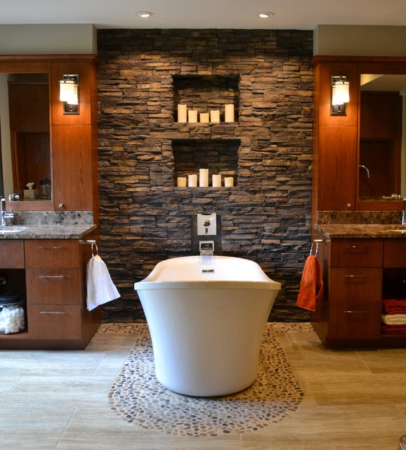 Example Of A Trendy Pebble Tile Floor Freestanding Bathtub Design In Cedar Rapids With Flat