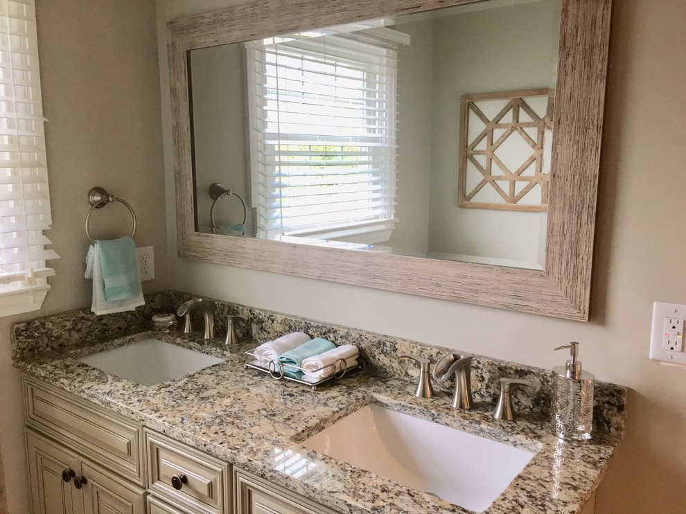 Inspiration for a small country master bathroom remodel in Other with raised-panel cabinets, beige cabinets, beige walls, an undermount sink, granite countertops and multicolored countertops
