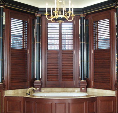 Stained african mahogany shutter panels traditional bathroom boston by back bay shutter for Exterior window shutters south africa