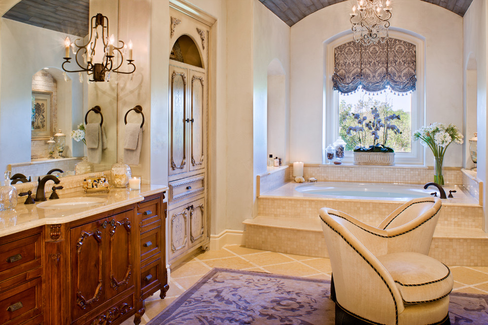 Elegant bathroom photo in Austin with marble countertops
