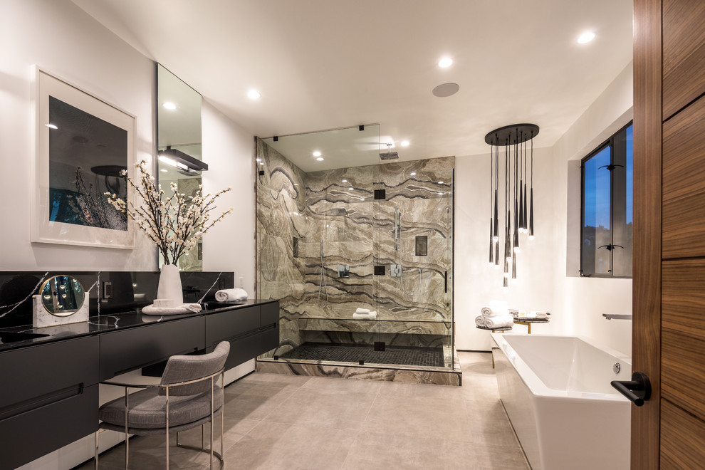 Inspiration for a contemporary beige tile gray floor bathroom remodel in Los Angeles with flat-panel cabinets, black cabinets, white walls and a hinged shower door