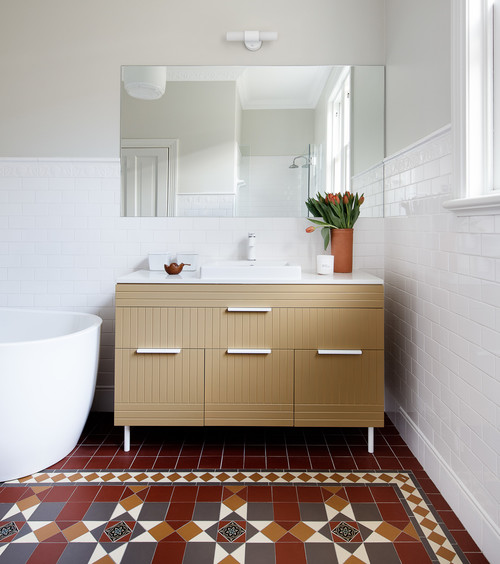 beige vanity with heritage morroccan tiles in bathroom