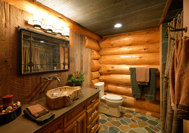 Mountain style bathroom photo in Minneapolis with a vessel sink and medium tone wood cabinets