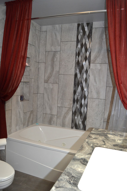 Bathroom - mid-sized transitional master gray tile and porcelain tile porcelain floor and gray floor bathroom idea in Other with flat-panel cabinets, gray cabinets, a two-piece toilet, gray walls, an undermount sink, laminate countertops and gray countertops