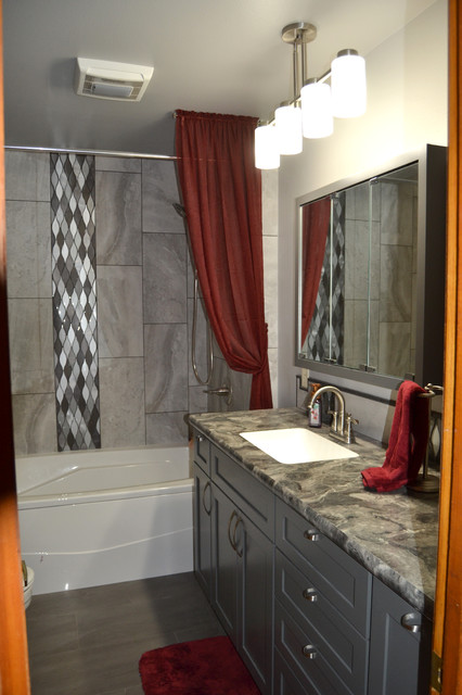 Mid-sized transitional master gray tile and porcelain tile porcelain floor and gray floor bathroom photo in Other with flat-panel cabinets, gray cabinets, a two-piece toilet, gray walls, an undermount sink, laminate countertops and gray countertops