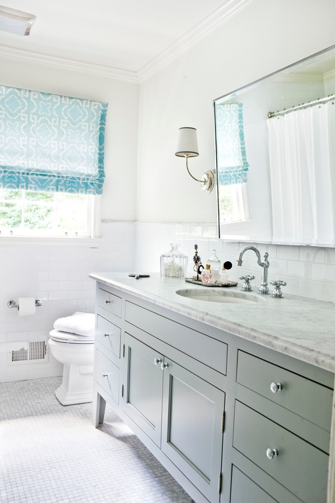 Inspiration for a contemporary white tile bathroom remodel in Atlanta with an undermount sink, recessed-panel cabinets and gray cabinets