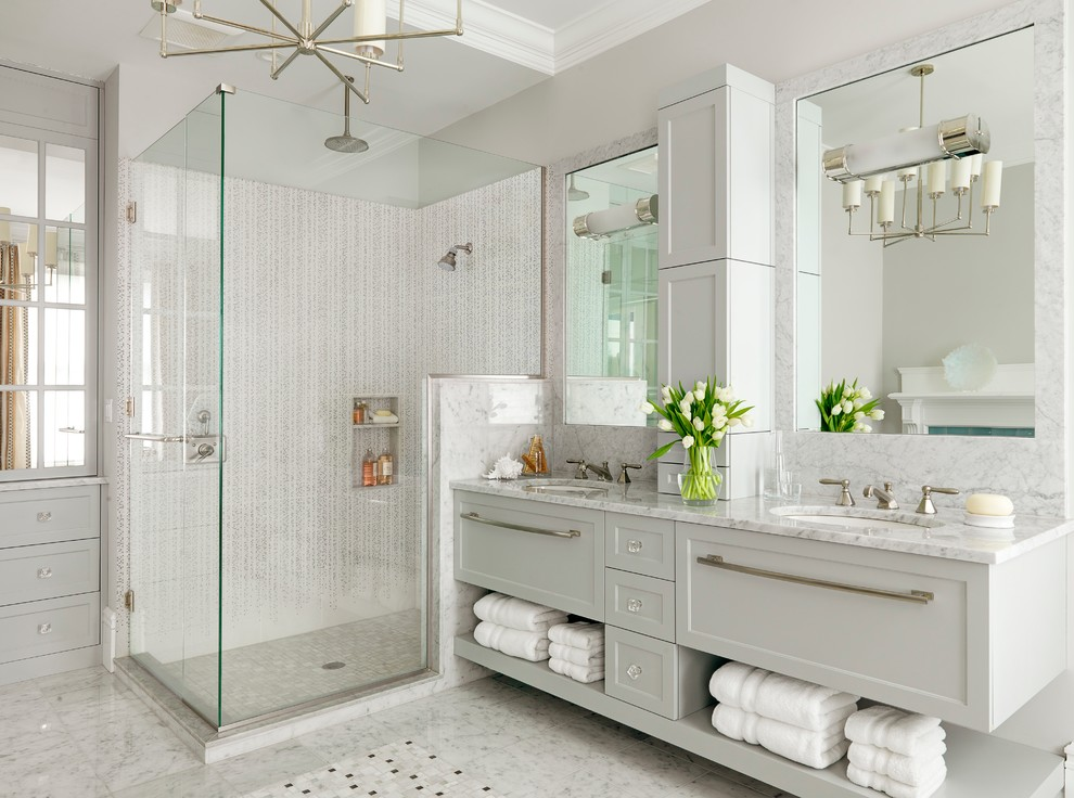 Trendy white tile corner shower photo in St Louis with an undermount sink, shaker cabinets, white cabinets and gray countertops