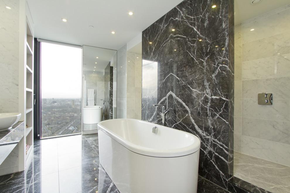 Trendy marble tile bathroom photo in London