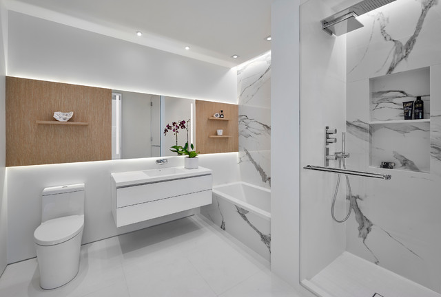 Mid-sized trendy master black and white tile and white tile white floor bathroom photo in Chicago with flat-panel cabinets, white cabinets, white walls, an integrated sink and white countertops