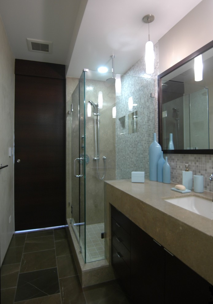 Corner shower - mid-sized modern master beige tile and glass tile corner shower idea in San Francisco with flat-panel cabinets, dark wood cabinets, an undermount tub, a one-piece toilet, white walls, an undermount sink and granite countertops