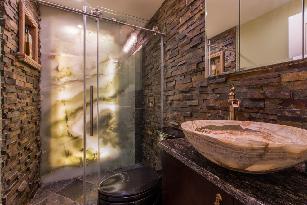 Inspiration for a mid-sized rustic 3/4 brown tile, gray tile and porcelain tile ceramic tile alcove shower remodel in New York with a vessel sink, flat-panel cabinets, dark wood cabinets, brown walls, granite countertops and gray countertops