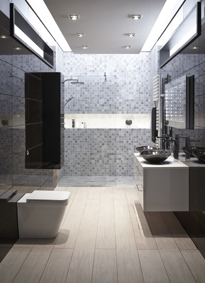 Walk-in shower - large contemporary master gray tile and mosaic tile light wood floor walk-in shower idea in Hertfordshire with a vessel sink, flat-panel cabinets, black cabinets, a one-piece toilet and black walls