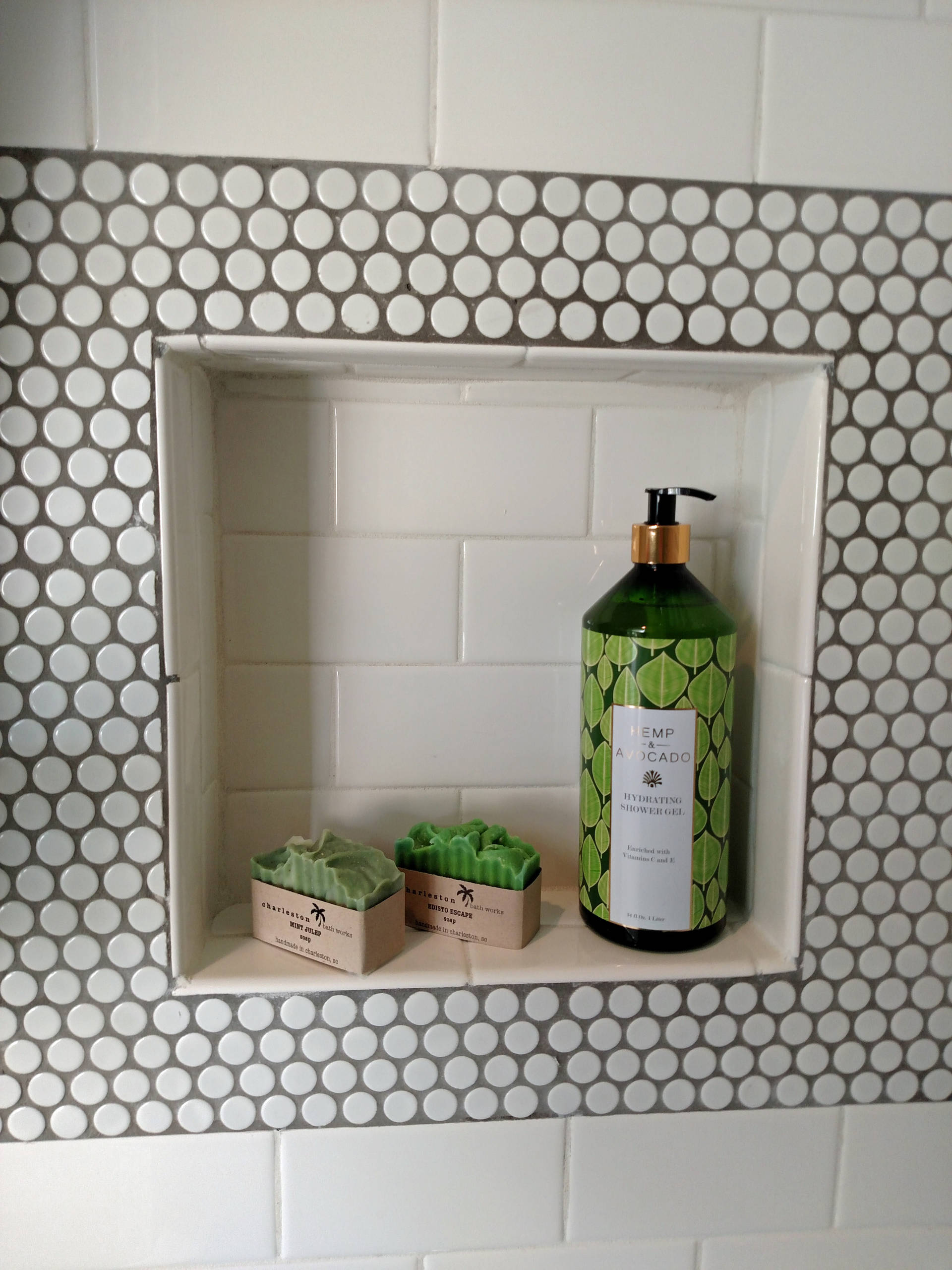 Subway tile with Penny tile accents and floor in a family bathroom.