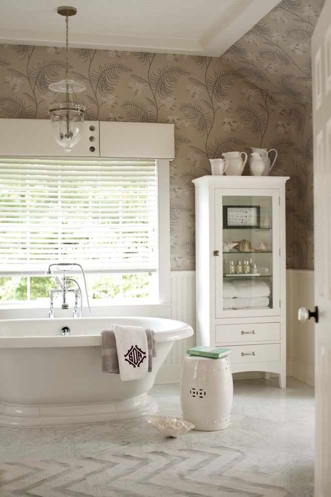 Example of a transitional freestanding bathtub design in New York