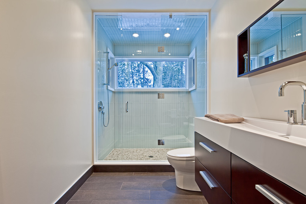 Mountain style blue tile and glass tile alcove shower photo in Toronto with a trough sink, flat-panel cabinets and dark wood cabinets