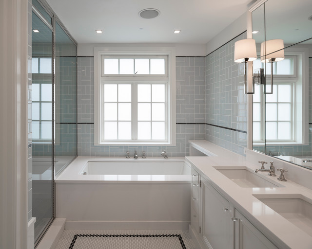 Transitional white tile and subway tile mosaic tile floor corner shower photo in New York with an undermount sink, an undermount tub and blue walls